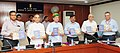 Arjun Ram Meghwal and the Minister of State for Human Resource Development and Water Resources, River Development and Ganga Rejuvenation, Dr. Satya Pal Singh jointly releasing a Swachhta Booklet on the activities.jpg