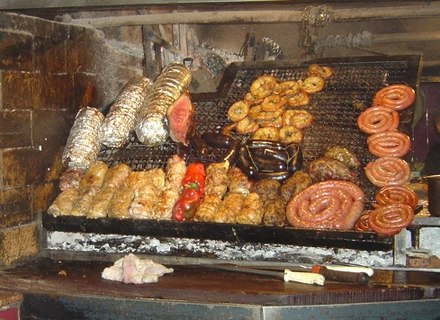 Asado with achuras (offal) and sausages. Asado is a term for barbecuing and the social event of having or attending a barbecue in Argentina, Uruguay, Paraguay, Chile and southern Brazil. Asado uruguayo.JPG