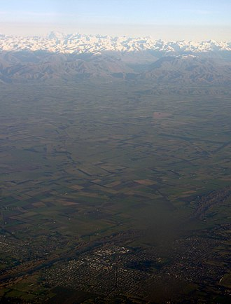 Ashburton, New Zealand - Aerial view of Ashburton, with the Southern Alps in the background