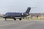 Australian Corporate Jet Centres (VH-SCR) Bombardier CL-600-2B16 Challenger 604 taxiing at Wagga Wagga Airport (1).jpg