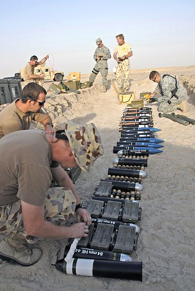 File:Australian army ammunition technicians and U.S. airmen lay down plastic explosive over munitions during a controlled detonation at a range in Southwest Asia (080620-F-9876D-244).jpg