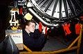 Aviation Machinist's mate AIRMAN J. Roy removes a part from a jet aircraft engine in the Aircraft Intermediate Maintenance Department shop - DPLA - 06fe58840a5b0acec61e677e6aa449d5.jpeg