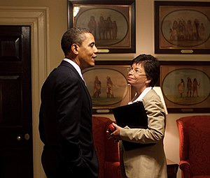 Valerie Jarrett - Obama speaks with Jarrett in a West Wing corridor.