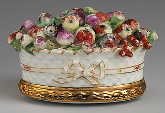 "Chelsea porcelain factory - A ""Chelsea Toy"" in the form of a basket of fruit, width 2 3/4 inches (4.1 × 7 cm), c. 1755, inscribed ""MON AMOUR LES A CUEILLI POUR VOUS"" (""my love gathered these for you"")."