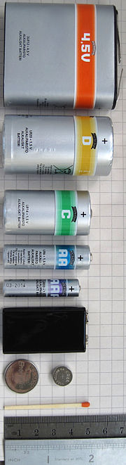 From top to bottom: Two button cells, a 9-volt PP3 battery, an AAA battery, an AA battery, a C battery, a D battery, a large 3R12.