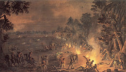 Painting showing men killing one another in the light of campfires. The scene is an open field at the edge of a forest.