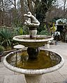 Beer garden ornamental fountain at Ashfold Crossways, in Lower Beeding, West Sussex.jpg