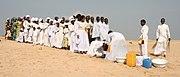 Igreja Celestial de Cristo batismo em  Cotonou. Cinco por cento da população do Benin  pertence à Igreja Celestial de Cristo, uma African Initiated Church.