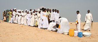 Benin - A Celestial Church of Christ baptism in Cotonou. Five percent of Benin's population belongs to this denomination, an African Initiated Church.