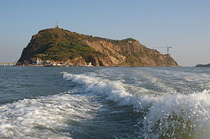 Jinzhou - Photograph of Mount Bijia at high tide.