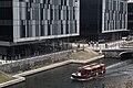 Boat running next to Waterway House.jpg