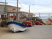 Boats left nearby the 'costanera' for safety in Pichilemu, March 11, 2011.jpg