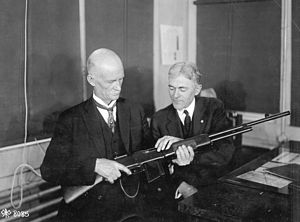 M1918 Browning Automatic Rifle - John M. Browning, the inventor of the rifle, and Burton, the Winchester expert on rifles, discussing the finer points of the BAR at the Winchester plant