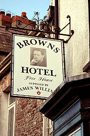 Dylan's image on the pub sign of his Laugharne 'local', Browns Hotel