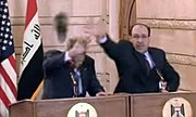 George W. Bush (l) and Nouri al-Maliki (r) defend themselves against a thrown shoe