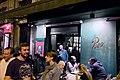 Busy street outside dinner fado destination Povo (47832521291).jpg