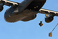 C-17 Globemaster III of the 437th and 315th Airlift Wings at Charleston AFB drops cargo at a remote airfield during a brigade airdrop exercise.jpg