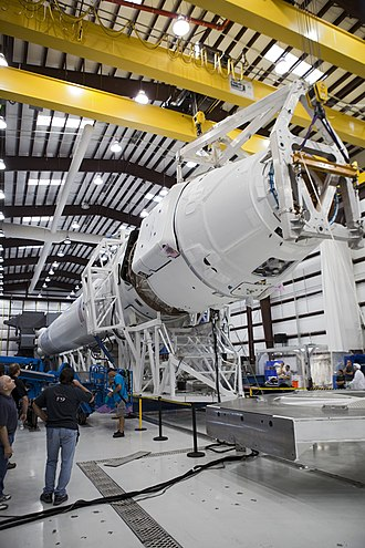 Commercial Resupply Services - SpaceX Dragon spacecraft being integrated with Falcon 9 launch rocket, 2012