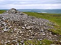 Cairn with Malham Tarn in distance - geograph.org.uk - 1367073.jpg