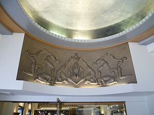 Cambridge Theatre - The frieze above the entrance.