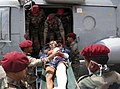 Casualties brought from Lamabagar to Kathmandu by an Indian Air Force (IAF) Mi-17 V5, being received by the Indian Paramedical team, post a recent massive earthquake occurred in Nepal on May 13, 2015 (1).jpg