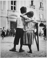 Children in Naples, Italy. Little boy helps one-legged companion across street. - NARA - 520940.tif