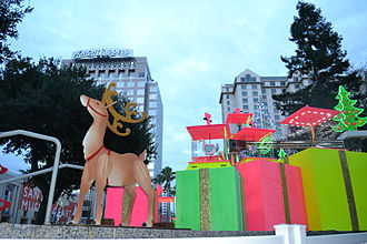 Christmas in the Park (San Jose) - A display with downtown buildings in background