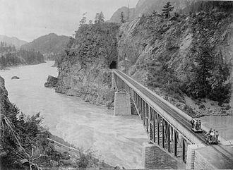 Cisco Bridges - The original CPR Cisco Bridge, c. 1900. Cantilever Bar Tunnel in background. Photo facing downriver.