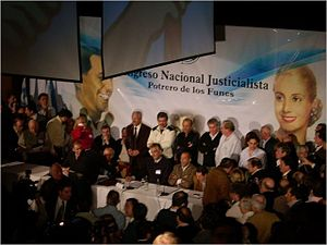 San Luis Province - San Luis Justicialist Party officials confer under the images of Juan and Evita Perón. The Rodríguez Saá brothers are seated in the middle.