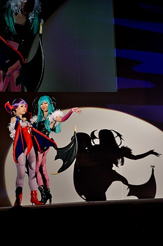 Darkstalkers - Cosplayers of Lilith and Morrigan on stage at the Tokyo Game Show 2011