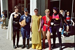 Photograph of five people standing together in costume