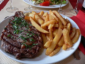 Ribs (food) - Beef rib, a French style bone-in rib eye steak, served with french fries