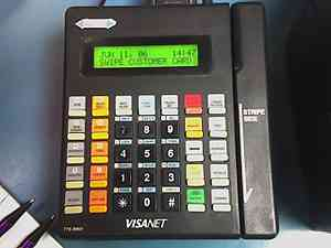 A typical credit card terminal popular in 2005, now typically out of use and of a style/era usually non-compliant per PCI-DSS standards.