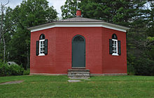 The Eight Square Schoolhouse, a red eight-sided one-room schoolhouse, in 2008