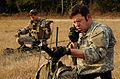 Defense.gov News Photo 110302-F-IE715-055 - U.S. Army soldiers assigned to the 4th Battalion 10th Special Forces Group call in an operation schedule during Emerald Warrior 2011 in.jpg