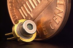 A packaged laser diode with penny for scale.