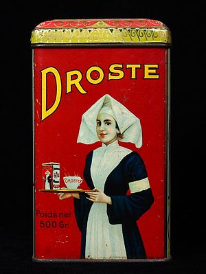Recursion - A visual form of recursion known as the Droste effect. The woman in this image holds an object that contains a smaller image of her holding an identical object, which in turn contains a smaller image of herself holding an identical object, and so forth. 1904 Droste cocoa tin, designed by Jan Misset