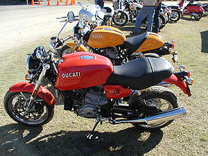 Ducati SportClassic - A red Ducati GT1000. A yellow Sport1000 is in the background, with a silver Paul Smart visible further back.