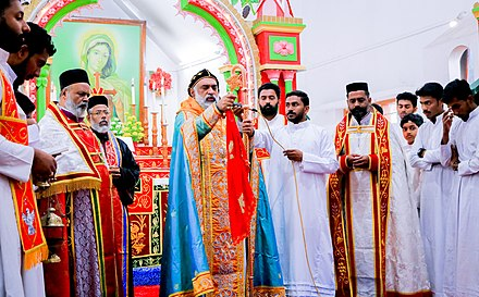 Liturgical vestments of clergy. Eucharist at St. Mary's Church, Meenangadi.jpg