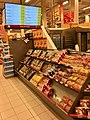Extra Coop Supermarket, Amfi Shopping Mall, Osøyro, Hordaland, Norway, 2018-03-22. Shop interior, shelves in rack with some breads and cookies, pricelist on screen, etc.jpg