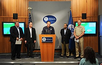 Hurricane Gustav - Federal Emergency Management Agency (FEMA) Administrator David Paulison (center) with various United States' federal officials and other response leaders on August 30.