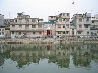 Walled villages of Hong Kong - Houses reflecting in a pond at Fanling Wai.