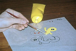 Traditional animation - Painting with acrylic paint on the reverse side of an already inked cel.
