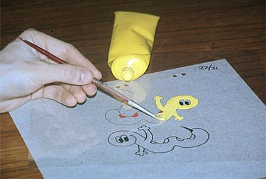 Painting with acrylic paint on the reverse side of an already inked cel.