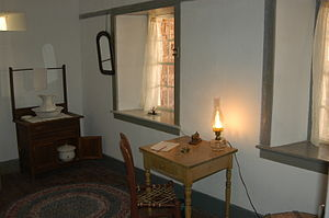 Eliza Stewart Udall - Eliza Stewart's bedroom at Pipe Spring National Monument showing a recreation of the telegraph terminal.