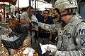Flickr - DVIDSHUB - U.S. Soldier Pays an Iraqi Vendor.jpg