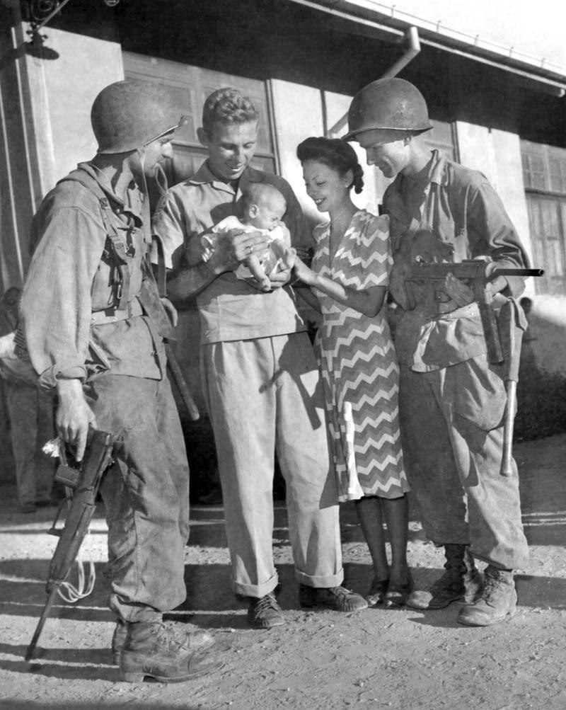 Former internees of Los Banos with 11th Airborne troopers, 1945