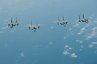 44th Fighter Squadron - Four squadron F-15 Eagles in formation off the coast of Japan