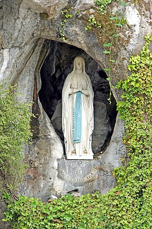 Our Lady of Lourdes - The statue within the rock cave at Massabielle in Lourdes, where Saint Bernadette Soubirous claimed to have witnessed the Blessed Virgin Mary, though however she disapproved of its  artistic demeanor. Now a religious grotto.