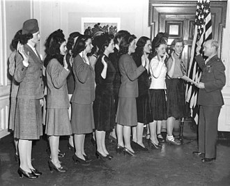 United States Marine Corps Women's Reserve - Women enlistees being sworn into the Marine Corps Women's Reserve in the New York area, 1943. Official USMC photograph